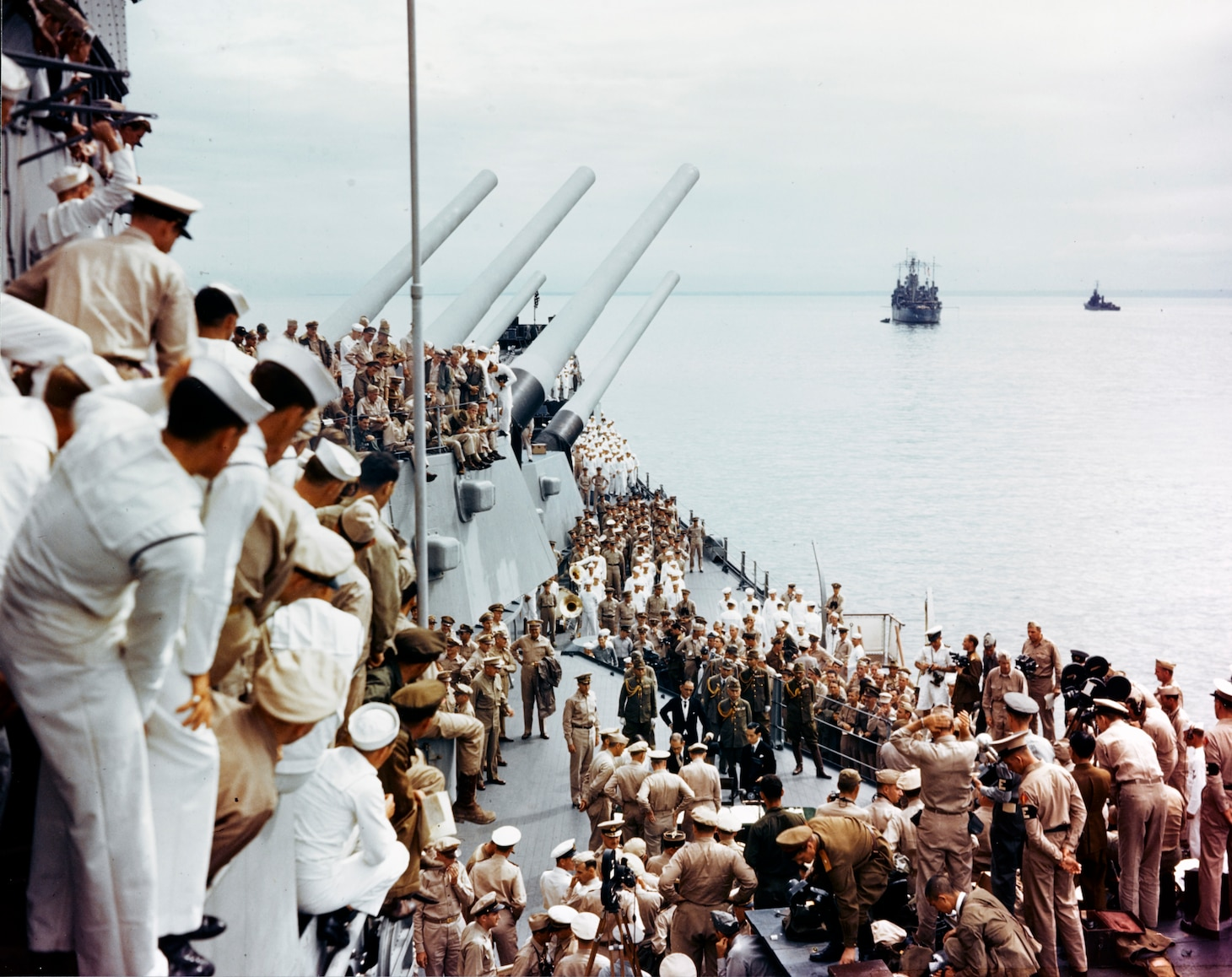 Sailors aboard the battleship USS Missouri (BB-63) watch the signing of the Instrument of Surrender, Sept. 2, 1945 in Tokyo Bay.