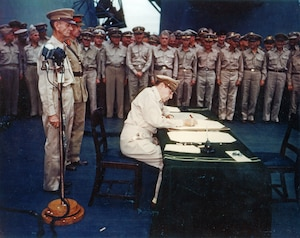 General of the Army Douglas MacArthur signs the signs the Instrument of Surrender as Supreme Allied Commander aboard the battleship USS Missouri (BB-63) in Tokyo, Japan, Sept. 2, 1945.
