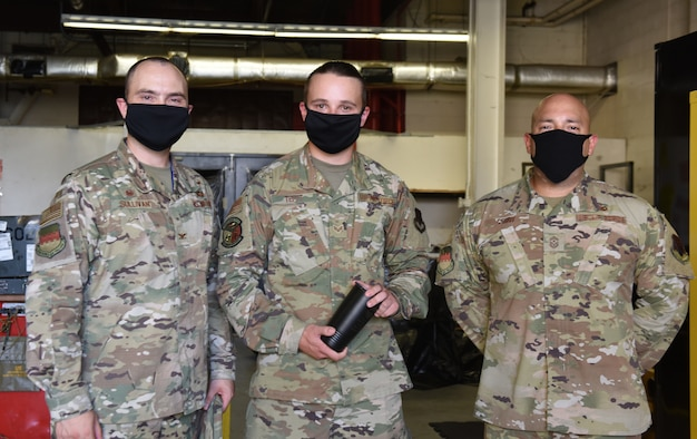 U.S. Air Force Col. Lawrence Sullivan, 20th Fighter Wing (FW) commander, left, Senior Airman Trevor Tefft, 20th Equipment Maintenance Squadron wheel and tire crash recovery team member, center, and Chief Master Sgt. Steve Cenov, 20th FW command chief, stand together for an award photo, at Shaw Air Force Base, South Carolina, Aug. 28, 2020.
