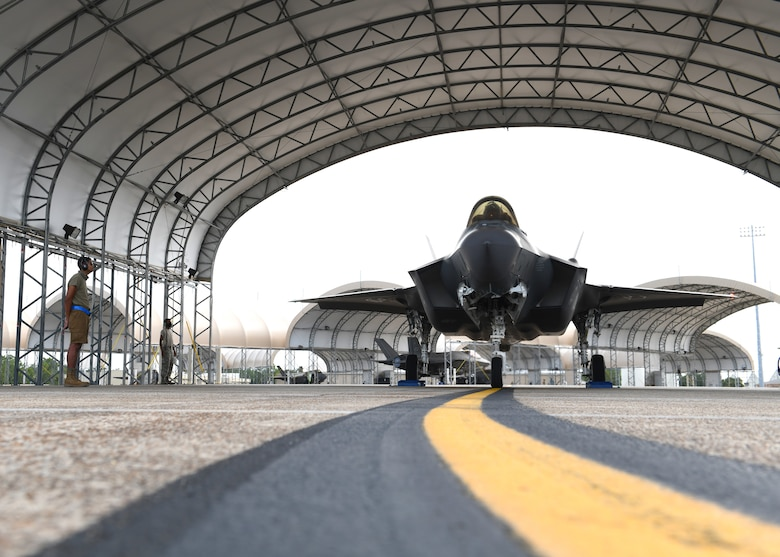 U.S. Air Force Airman 1st Class Jaivon Bland, 33rd Aircraft Maintenance squadron F-35A Lightning II dedicated crew chief, conducts launch procedures at Eglin Air Force Base, Florida, Aug. 26, 2020. The 33rd AMXS introduced a shorts uniform to help combat hot weather conditions on the flightline. (U.S. Air Force photo by Airman 1st Class Amber Litteral)