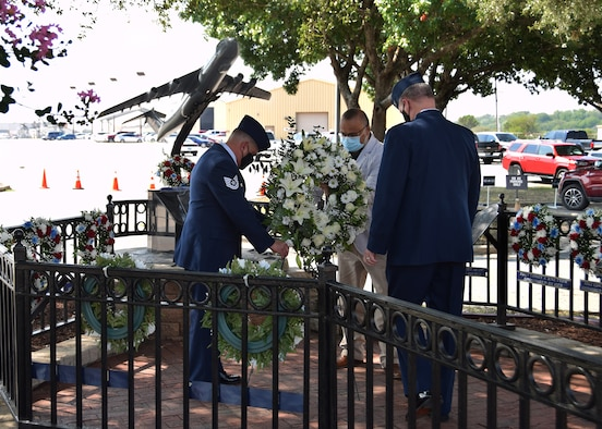 Tech. Sgt. Joe Perez, 26th Aerial Port Squadron ramp service supervisor, John P. Perez, and Col. Terry W. McClain, 433rd Airlift Wing commander, lay a wreath at the BRAVO-12 memorial Aug. 28, 2020 at Joint Base San Antonio-Lackland, Texas.
