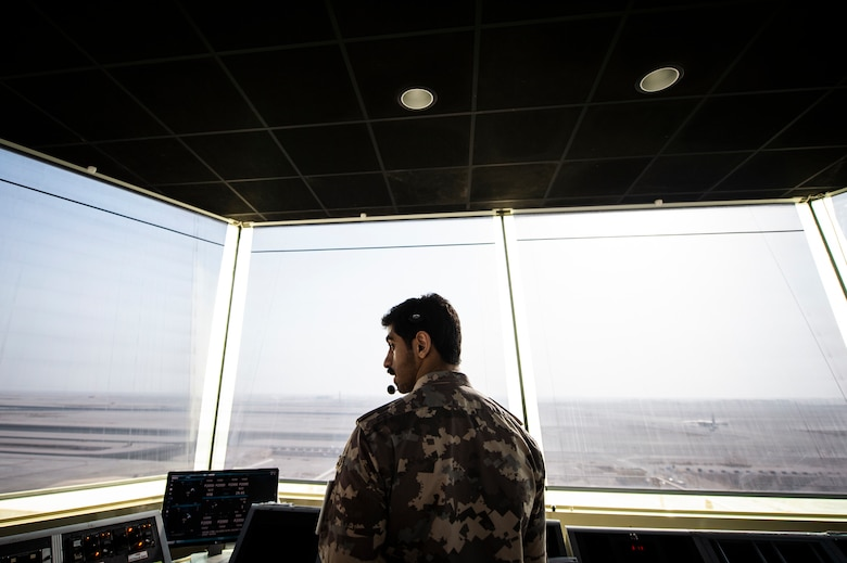 A member of the Qatar Emiri Air Force (QEAF) air traffic control tower directs aircraft at Al Udeid Air Base, Qatar, Aug. 24, 2020. A letter of agreement was recently implemented between the U.S., QEAF and Qatar Civil Aviation Authority to better work together to ensure safe air space operations. (U.S. Air Force photo by Master Sgt. Larry E. Reid Jr.)