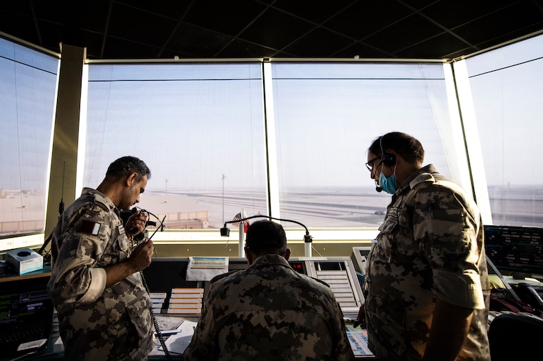 Members of the Qatar Emiri Air Force (QEAF) air traffic control tower work together to direct aircraft at Al Udeid Air Base, Qatar, Aug. 24, 2020. A letter of agreement was recently implemented between the U.S., QEAF and Qatar Civil Aviation Authority to better work together to ensure safe air space operations. (U.S. Air Force photo by Master Sgt. Larry E. Reid Jr.)