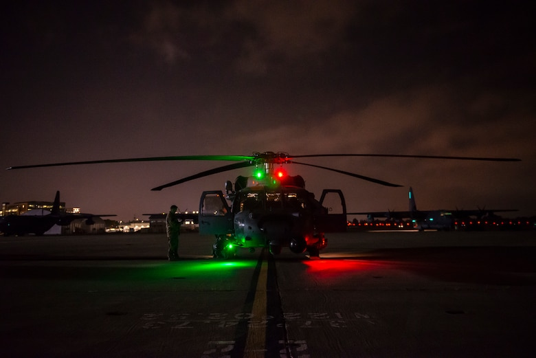 a photo of an HH-60 sitting on the flightline