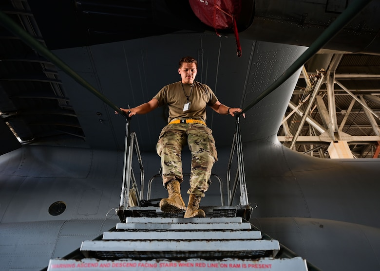 An Airman walks down a set of stairs