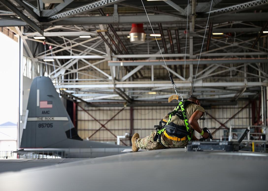 An Airman works on an aircraft