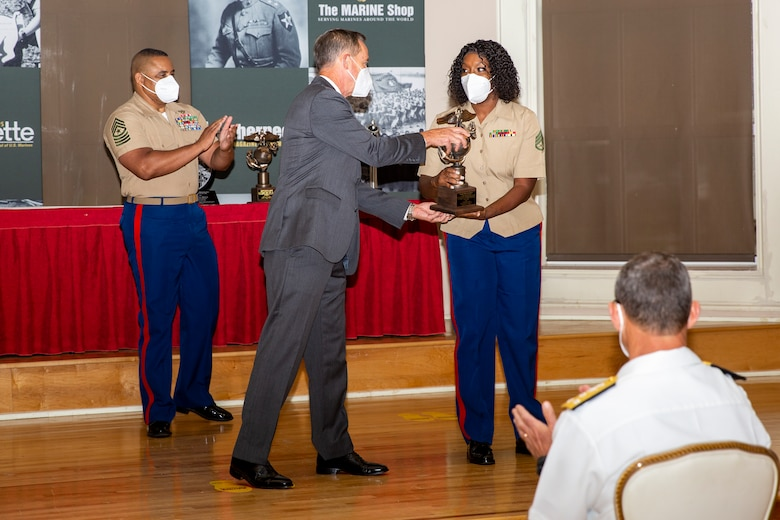William Faulkner, center, President and CEO of Marine Corps Association and Foundation (MCA&F), presents the Section Leader of the Year award to U.S. Marine Corps Staff Sgt. Marquita Davis, right, a section leader with Wounded Warrior Battalion-East, during the 10th annual Wounded Warrior Leadership Awards ceremony hosted by the MCA&F, at the Marston Pavilion on Marine Corps Base Camp Lejeune, North Carolina, Aug. 20, 2020. Six Marines and civilians with the Wounded Warrior Regiment were recognized by MCA&F for their professionalism, exceptional leadership and achievements.  (U.S. Marine Corps photo by Lance Cpl. Christian Ayers)
