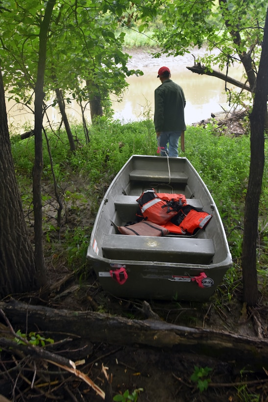 Man pulls boat toward river