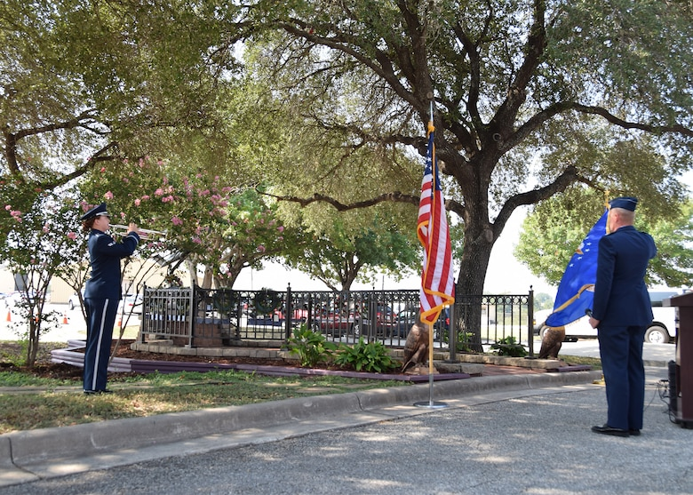 Airman 1st Class Clare W. Hogan, Band of the West, plays Taps at a remembrance and wreath laying ceremony for the fallen Airmen from mission BRAVO-12 Aug. 28, 2020 at Joint Base San Antonio-Lackland, Texas.