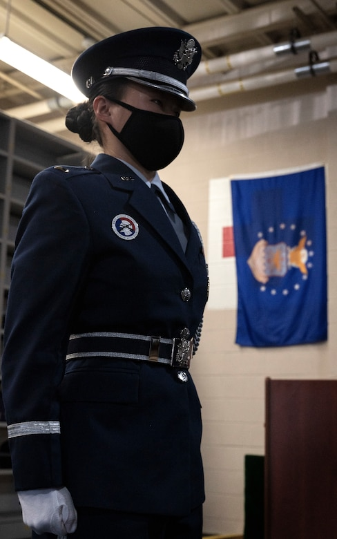 An Airman stands at the position of attention