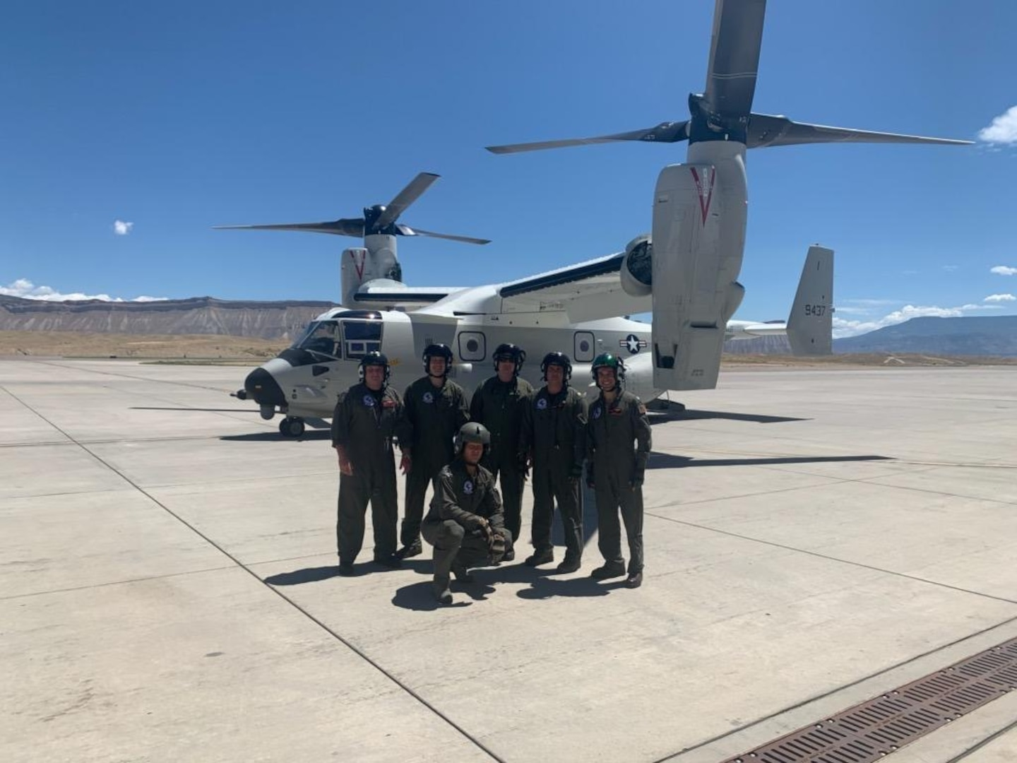 Defense Contract Management Agency personnel from DCMA Bell and DCMA Boeing stand in front of the first Navy CMV-22