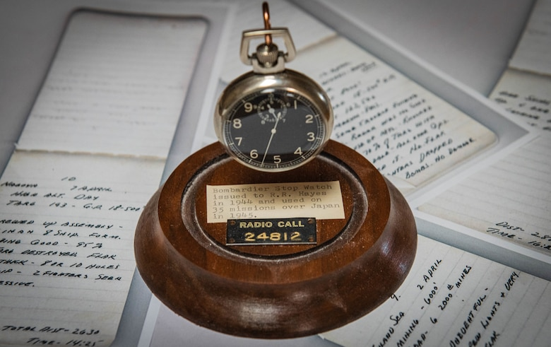 A bombardier stopwatch sits on photo copies of diary entries Aug. 12, 2020, in Sun City, Ariz.