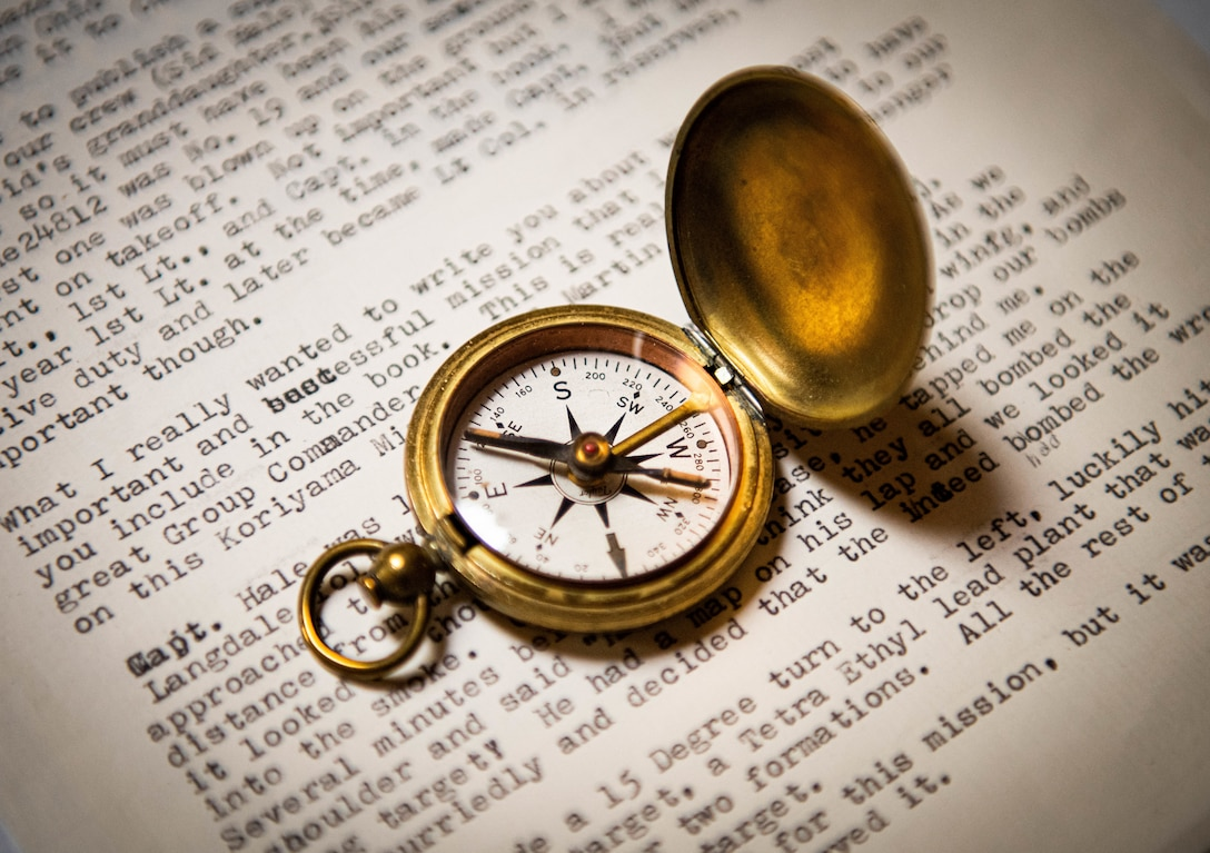 A compass sits on a letter Aug. 12, 2020, in Sun City, Ariz.