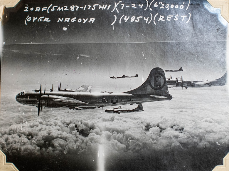 Several B-29 Superfortresses fly over Nagoya, Japan, during World War II.