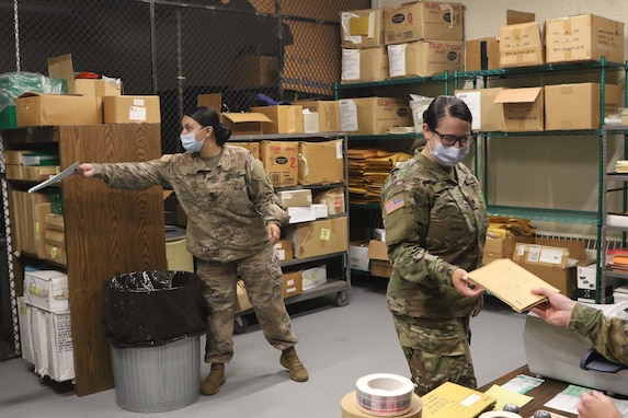 Soldiers like Spc. Dulcina Fragata, a HR specialist who is a graduate of the Army's Postal Operations Course, demonstrated how to accept the various kinds of mail from Soldiers in a deployed environment.
