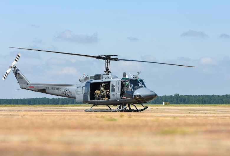Airmen assigned to the 23rd Flying Training Squadron at Fort Rucker, Alabama land on the flightline in a UH-1N Huey on August 19, 2020, at Columbus Air Force Base, Miss. When configured for passengers, the UH-1N can seat up to 13 people, but actual passenger loads are dependent on fuel loads and atmospheric conditions. (U.S. Air Force photo by Airman 1st Class Davis Donaldson)