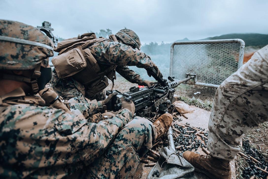 U.S. Marines fire an M2 .50 caliber machine gun on Camp Hansen, Okinawa, Japan, Aug. 26.