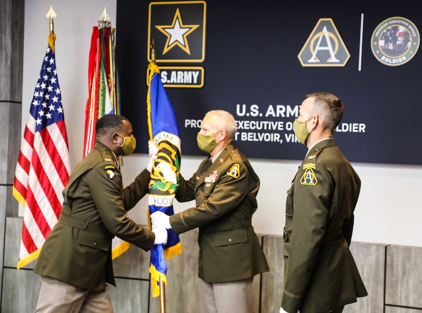 Col. Stephen Thomas passes the Army Acquisition Corps flag to Brig. Gen. Anthony Potts, signifying the relinquishing of his Project Manager responsibilities during the PM SSV change of charter at Fort Belvoir, Va., August 21, 2020.