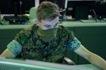 A U.S. Marine monitors network activity from the operations floor at Marine Corps Base Quantico, Va., Aug. 31.