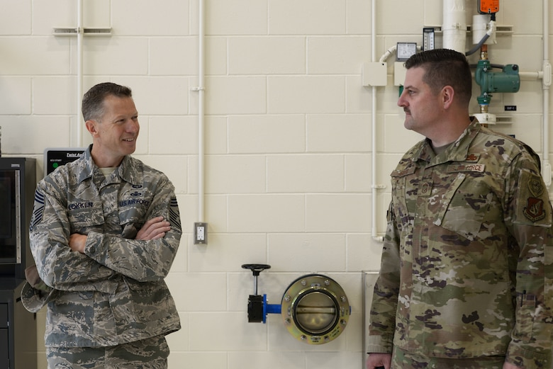 U.S. Air Force Chief Master Sgt. John Lokken, the 354th Fighter Wing command chief, talks with Chief Master Sgt. Robert Soto, the 354th Aircraft Maintenance Squadron (AMXS) superintendent, on Eielson Air Force Base, Alaska, Aug. 28, 2020.