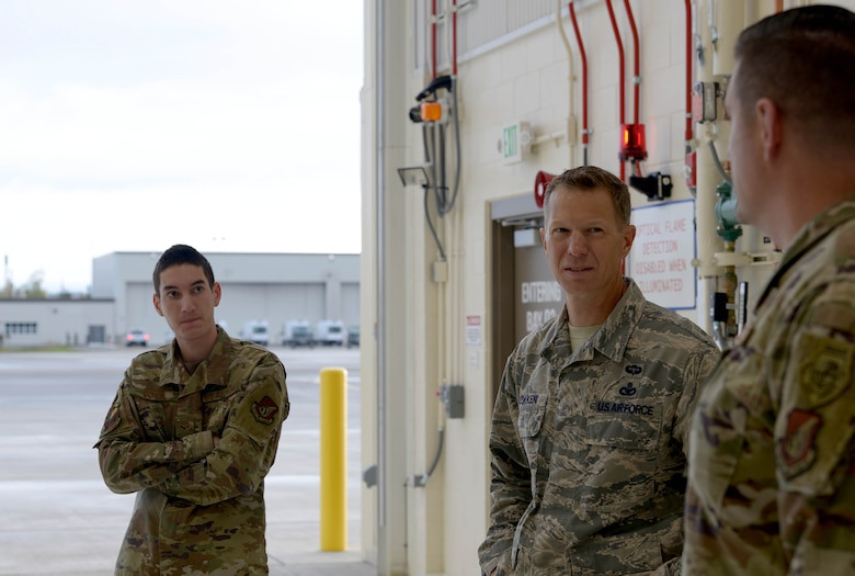 U.S. Air Force Chief Master Sgt. John Lokken, the 354th Fighter Wing (FW) command chief, talks with Chief Master Sgt. Robert Soto, the 354th Aircraft Maintenance Squadron (AMXS) superintendent, and Airman 1st Class Devin Duhon, 354th AMXS F-35A Lightning II crew chief, on Eielson Air Force Base, Alaska, Aug. 28, 2020.