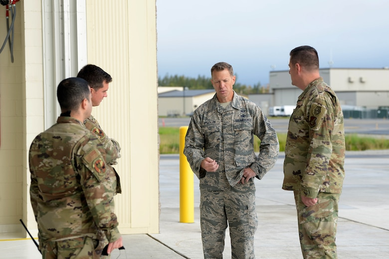 U.S. Air Force Chief Master Sgt. John Lokken, the 354th Fighter Wing command chief, talks with aircraft maintainers on Eielson Air Force Base, Alaska, Aug. 28, 2020.