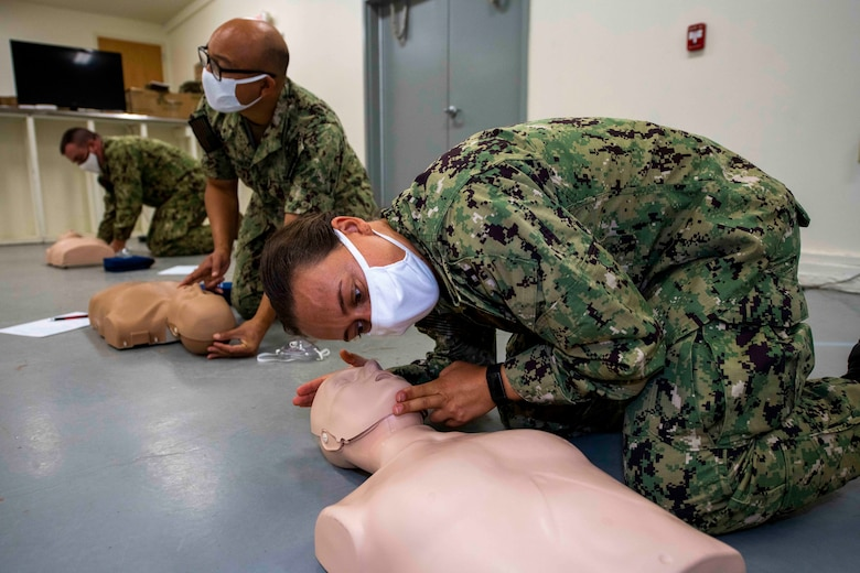 Petty Officer 3rd Class Mallory Tittle participates in CPR training prior to new recruit arrivals on board Fort McCoy, a U.S. Army training center in western Wisconsin.