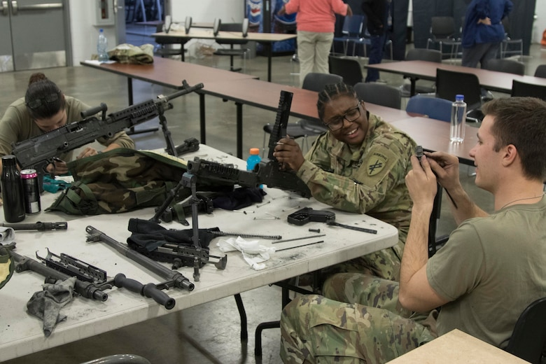 Soldiers from the 414th Civil Affairs Battalion clean and perform preventive maintenance on their weapons at the Robert L. Poxon Army Reserve Center in Southfield, Mich., Oct 19, 2019.