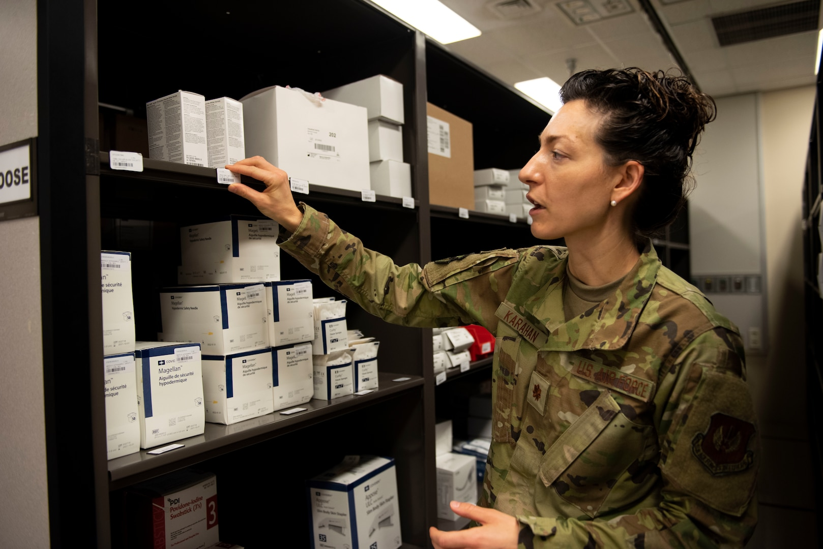 U.S. Air Force Maj. Crystal Karahan, 39th Medical Support Squadron Medical Logistics flight commander, checks the shelf labels in the medical supply storeroom at the base clinic.