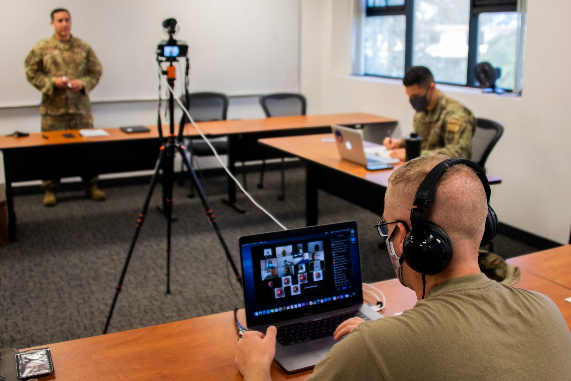 Capt. Matthew Schnarrs, 571st Mobility Support Advisory Squadron course facilitator, observes as Tech. Sgt. Larry Diaz, 571st MSAS instructor, gives a briefing on command and control operations during a virtual engagement with the National Aeronaval Service of Panama Sept. 1, 2020, at Travis Air Force Base in California. The two-week engagement is their first time using a virtual medium to train a partner nation and consists of an introductory command and control course and a multi-topic airfield operations course. (U.S. Air Force photo by Tech. Sgt. Liliana Moreno)