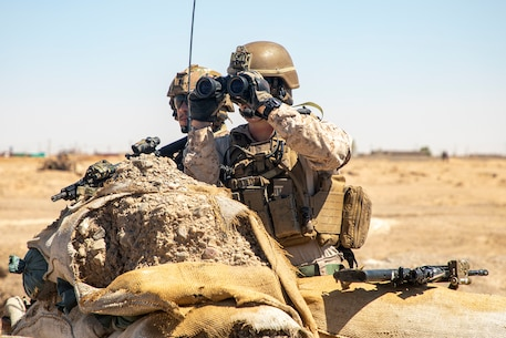 A U.S. Marine with Special Purpose Marine Air-Ground Task Force – Crisis Response – Central Command, and a U.S. Army soldiers with 2nd Brigade Combat Team, 82nd Airborne Division, maintain security during a joint security patrol in Syria, Aug. 23, 2020.