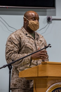 A U.S. Marine with Special Purpose Marine Air-Ground Task Force Crisis Response - Central Command 20.2, addresses the graduates of Corporal Course in Kuwait, Aug. 30, 2020.