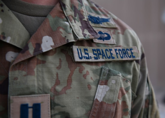 Capt. Ryan Vickers stands for a photo to display his new service tapes after taking his oath of office to transfer from the U.S. Air Force to the U.S. Space Force on Sept. 1, 2020, at Al Udeid Air Base, Qatar. The Space Force is the United States' newest service in more than 70 years. (U.S. Air Force photo by Staff Sgt. Kayla White)