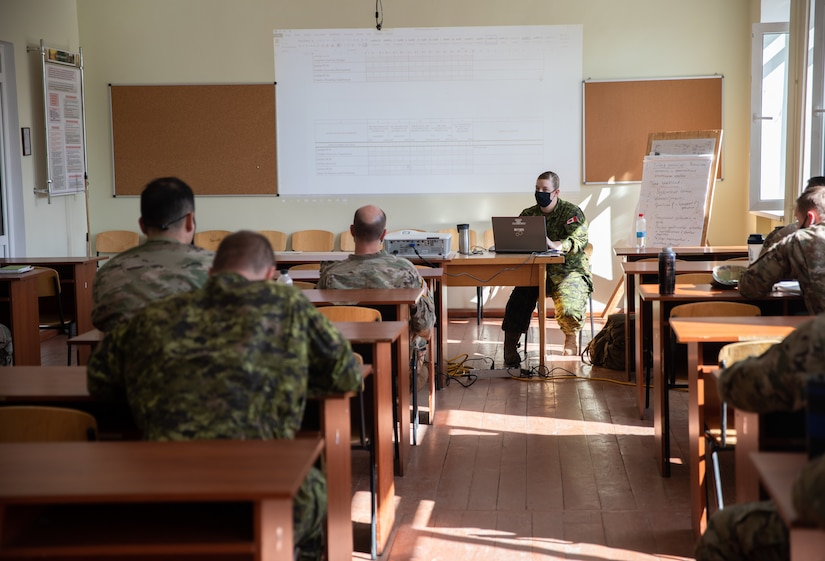 Canadian Forces Capt. Samantha Wall instructs Task Force Illini Soldiers on exercise design, Aug. 28 at Combat Training Center-Yavoriv, Ukraine.