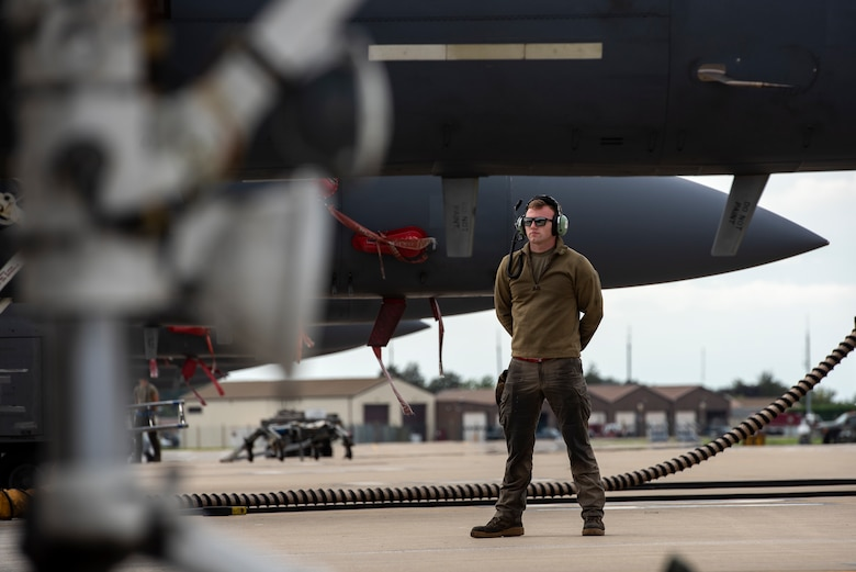 A U.S Air Force crew chief, assigned to the 494th Fighter Squadron, prepares for aircraft recovery after a training sortie at Royal Air Force Lakenheath, England, Sept. 2, 2020. The Liberty Wing is dedicated to maintaining combat readiness through daily training in order to safeguard U.S. national interests and those of NATO Allies and partners. (U.S. Air Force photo by Airman 1st Class Jessi Monte)