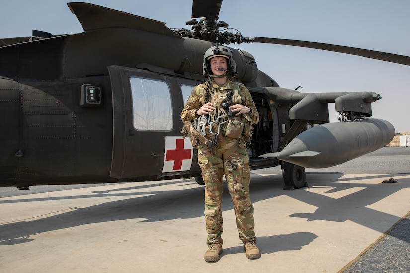 Sgt. Kayla Sampson stands in front of a UH-60 Black Hawk Helicopter while stationed in Camp Buehring, Kuwait on July 30, 2020. As a flight medic with Charlie Company, 2-238th General Aviation Support Battalion, Sampson performs all in-flight medical attention to patients during transport.