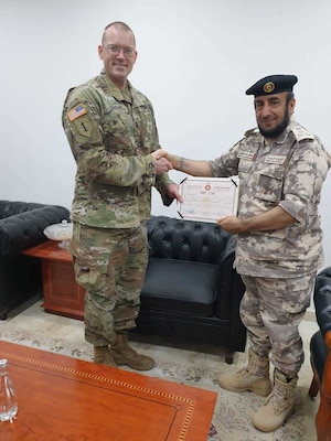 Capt. Allen Paul Jordan, the West Virginia National Guard's State Partnership Program – Qatar bilateral affairs officer, poses for a photo with Qatari Brig. Gen. Sultan Mohammed Sultan Al Shawani, multilingual school commander, following his graduation. Allen took part in a  3-week basic Arabic course offered at the Qatar Armed Forces Language Institute in Al Sheehaniya, Qatar.(Courtesy photo)