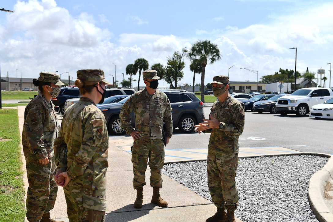 U.S. Air Force Maj. Gen. Sean L. Murphy (right), Air Force Deputy Surgeon General, greets 325th and 96th Medical Group leadership at Tyndall Air Force Base, Florida, Aug. 31, 2020. Murphy accompanied leaders from the Defense Health Agency on a tour of Tyndall to discuss the future of the base and DHA. (U.S. Air Force photo by Senior Airman Stefan Alvarez)
