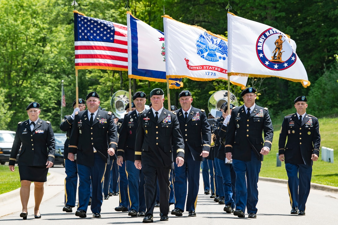 Members of the West Virginia Army National Guard and Honor Guard, led by Maj. Gen. James Hoyer, the WVNG Adjutant General, march to the internment ceremony of Chester West, a Medal of Honor recipient and World War I veteran May 12, 2018 at Donel C. Kinnard Memorial State Veterans Cemetery, Dunbar, W.Va. (U.S. Air National Guard Photo by Airman 1st Class Caleb Vance)