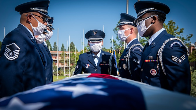Airmen from the High Frontier Honor Guard demonstrate a casket carry during their graduation Sept. 1, 2020, at Peterson Air Force Base, Colorado. This was the first graduation within the unit since the COVID-19 pandemic and the standup of the Peterson-Schriever Garrison. (U.S. Air Force photo by Airman 1st Class Jonathan Whitely)