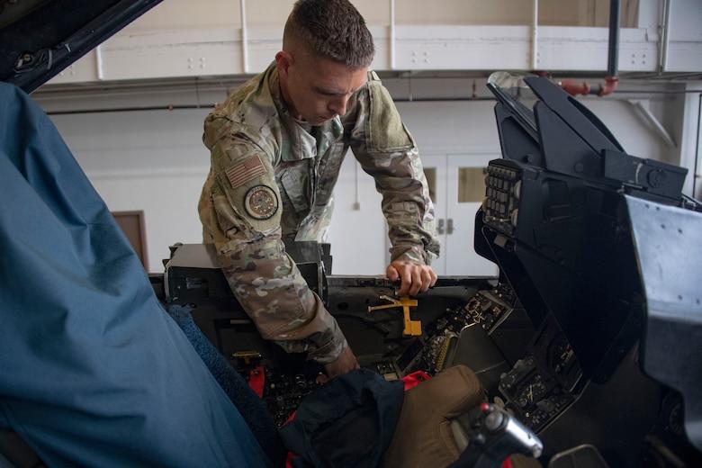 Airman 1st Class John Taylor Doolittle Jr. performs a safe-for-maintenance check