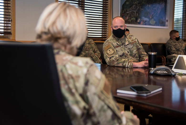 U.S. Air Force Lt. Col. Christopher Schnipke, 673d Civil Engineer Squadron commander, briefs U.S. Air Force Col. Kirsten Aguilar, Joint Base Elmendorf-Richardson and 673d Air Base Wing commander, during an immersion tour at JBER, Alaska, Aug. 28, 2020. Aguilar's tour focused on the 673d CES Airmen and their role in supporting the joint base partnership on the installation.