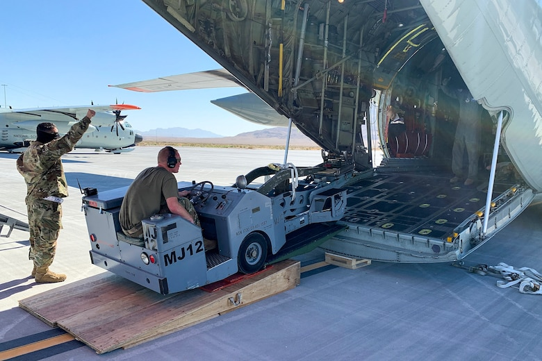 U.S. Air Force Airmen prepare to offload a weapon-loading jammer from a 109th Airlift Wing LC-130 Hercules aircraft Sept. 3, 2020, at Nellis Air Force Base, Nevada. Airmen are offloading cargo from the C-130 to prepare for an Integrated Combat Turn, which is the rapid re-arming and refueling of an aircraft. (Courtesy photo)