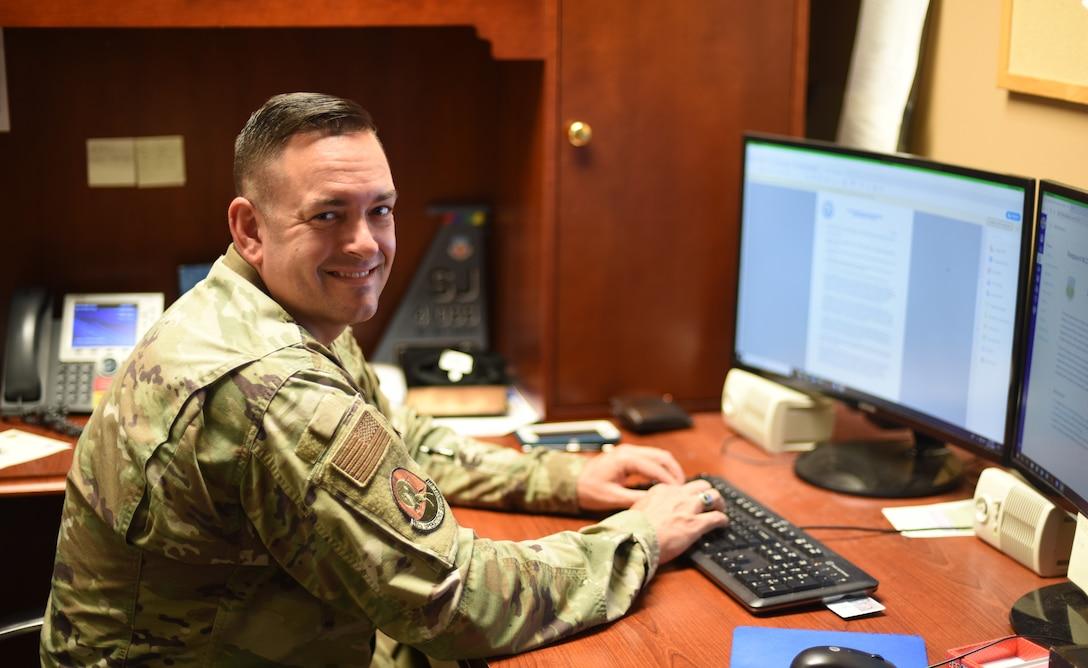 Man sits at desk
