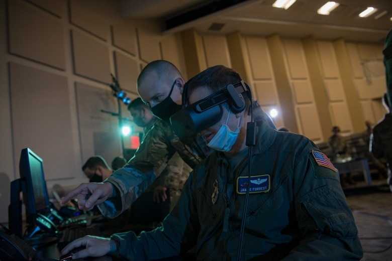 Lt. Col. James Forrest operates a virtual-reality headset in support of the Advanced Battle Management System, or ABMS, Onramp, Sept. 2, 2020, at Joint Base Andrews, Md. ABMS is the digital infrastructure which allows a level of connectivity and (sensor) compatibility for our military at war. (U.S. Air Force photo by Senior Airman Daniel Hernandez)