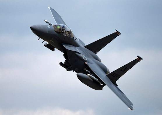 A U.S. Air Force F-15E Strike Eagle, assigned to the 494th  Fighter Squadron, flies overhead at Royal Air Force Lakenheath, England, Sept. 1, 2020. The 48th Fighter Wing conducts routine training in order to maintain combat readiness and safeguard U.S. national interests and the collective defense of allies and partners. (U.S. Air Force photo by Airman 1st Class Jessi Monte)