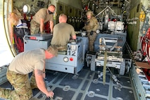 U.S. Air Force Airmen prepare to offload a weapon-loading jammer from a 109th Airlift Wing LC-130 Hercules aircraft Sept. 3, 2020, at Nellis Air Force Base, Nevada. Airmen participated in the Advanced Battle Management Onramp #2 exercise as a continuation of the Agile Combat Employment concept and to test the state-of-the-art ABMS, which is designed to enable combatant commanders the ability to control Department of Defense assets in real time. (Courtesy photo)