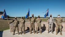 Incoming and outgoing unit commanders stand at parade rest.