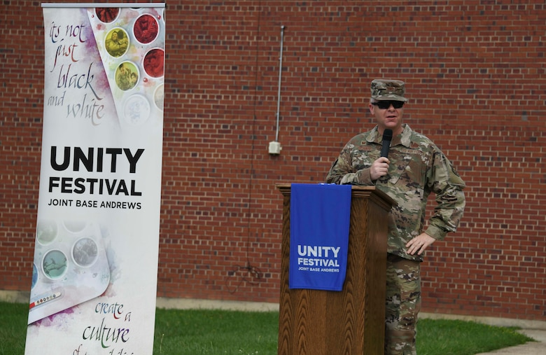 Col. Tyler R. Schaff, 316th Wing and Joint Base Andrews commander, gives opening remarks at the start of the JBA Unity Festival at JBA, Md., Sept. 3, 2020. This event was intended to unify the JBA community through the sharing of stories and experiences regarding inequity, racism and unconscious bias. (U.S. Air Force photo by Airman 1st Class Spencer Slocum)