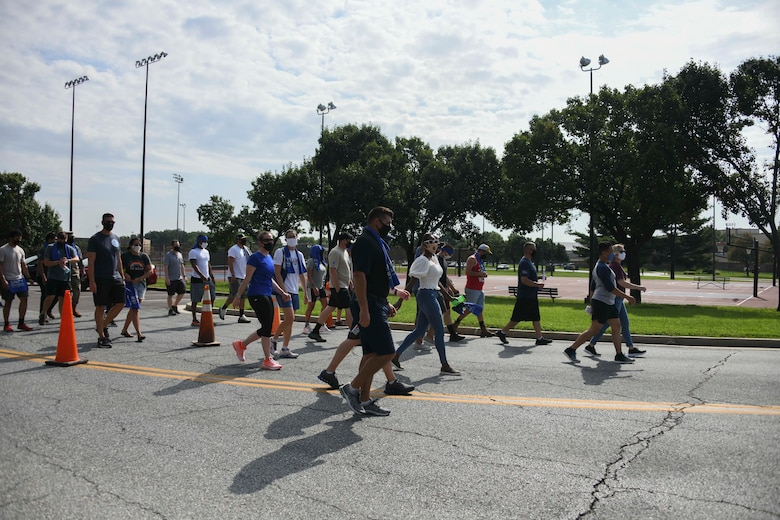 A group of walkers begin their 1.3-mile walk as part of the Joint Base Andrews Unity Festival at JBA, Md., Sept. 3, 2020. The walk was just one event during the festival intended to enhance both cross-cultural and cross-gender awareness and promote harmony amongst military members, their families and the civilian workforce. (U.S. Air Force photo by Airman 1st Class Spencer Slocum)